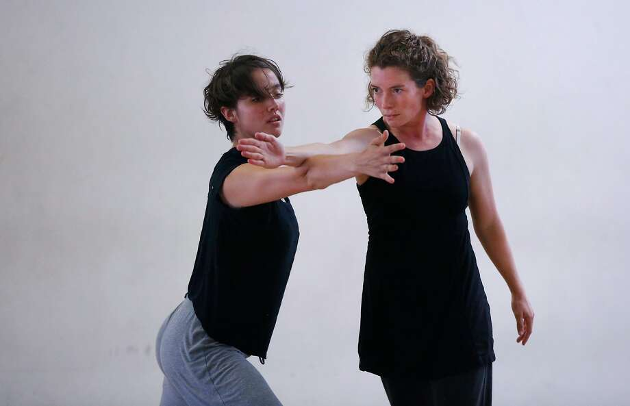 Alex Carrington (left) and Margaret Cromwell rehearse in the dance studio of the Margaret Jenkins Dance Company. Photo: Leah Millis, The Chronicle