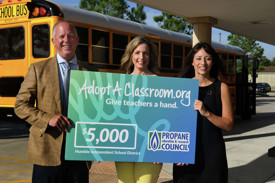 Tucker Perkins, from left, Propane Education & Research Council (PERC) President & CEO, presents a check for $5,000 to Humble ISD School Board President Angela Conrad, and HISD Superintendent Dr. Elizabeth Fagen, for River Pines Elementary School in HISD to be used for specific student-based programs at the school. (Photo by Jerry Baker/Freelance) Photo: Jerry Baker, Freelance / Freelance