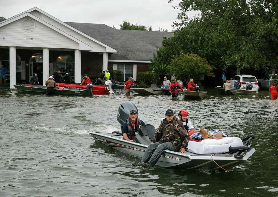 Patients were rescued from the waterlogged Cypress Glen nursing home in Port Arthur. Photo: Marcus Yam, MBR / Los Angeles Times
