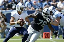 Tennessee Titans quarterback Marcus Mariota (8) is pressured by Oakland Raiders defensive tackle Justin Ellis (78) in the first half of an NFL football game Sunday, Sept. 10, 2017, in Nashville, Tenn. (AP Photo/Mark Zaleski)