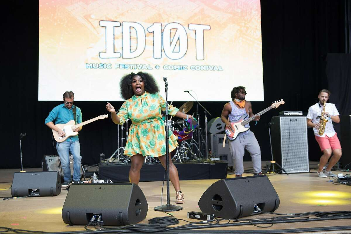 MOUNTAIN VIEW, CA - JUNE 24: Vocalist Tarriona Bal, bassist Jonathan Johnson and saxophonist Etienne Stouflet of Tank and the Bangas perform at ID10T festival at Shoreline Amphitheatre on June 24, 2017 in Mountain View, California.