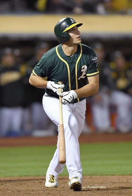 OAKLAND, CA - JUNE 30:  Matt Olson #28 of the Oakland Athletics swings and watches the flight of his ball as he hits a solo home run against the Atlanta Braves in the bottom of the ninth inning at Oakland Alameda Coliseum on June 30, 2017 in Oakland, California.  (Photo by Thearon W. Henderson/Getty Images) Photo: Thearon W. Henderson / Getty Images / 2017 Getty Images