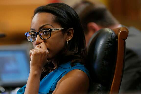 Supervisor Malia Cohen listens to fellow Supervisors as they discuss the Transbay Transit District special tax assessment, during the Board of Supervisors their Tuesday Sept. 23, 2014 meeting at City Hall in San Francisco, Calif.
