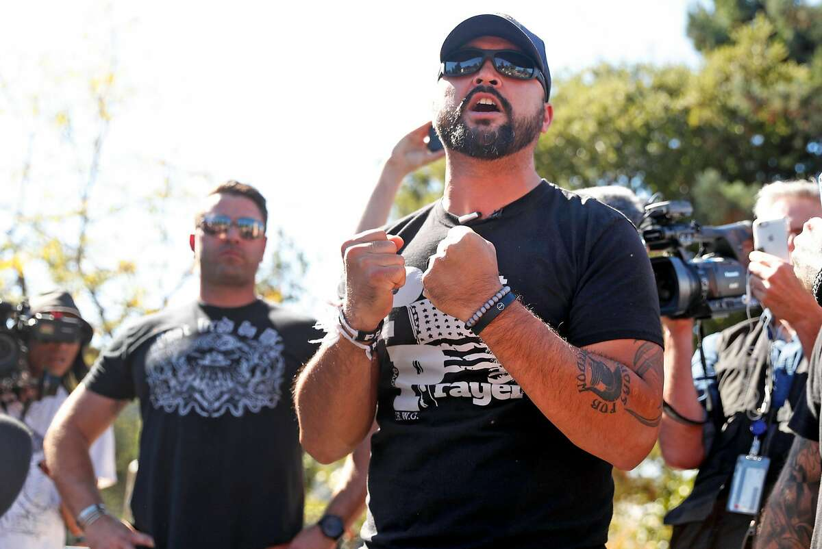 Patriot Prayer organizer Joey Gibson (right) and right wing activist Kyle Chapman on stage during a gathering at People's Park in Berkeley, Calif., on Tuesday, September 26, 2017.