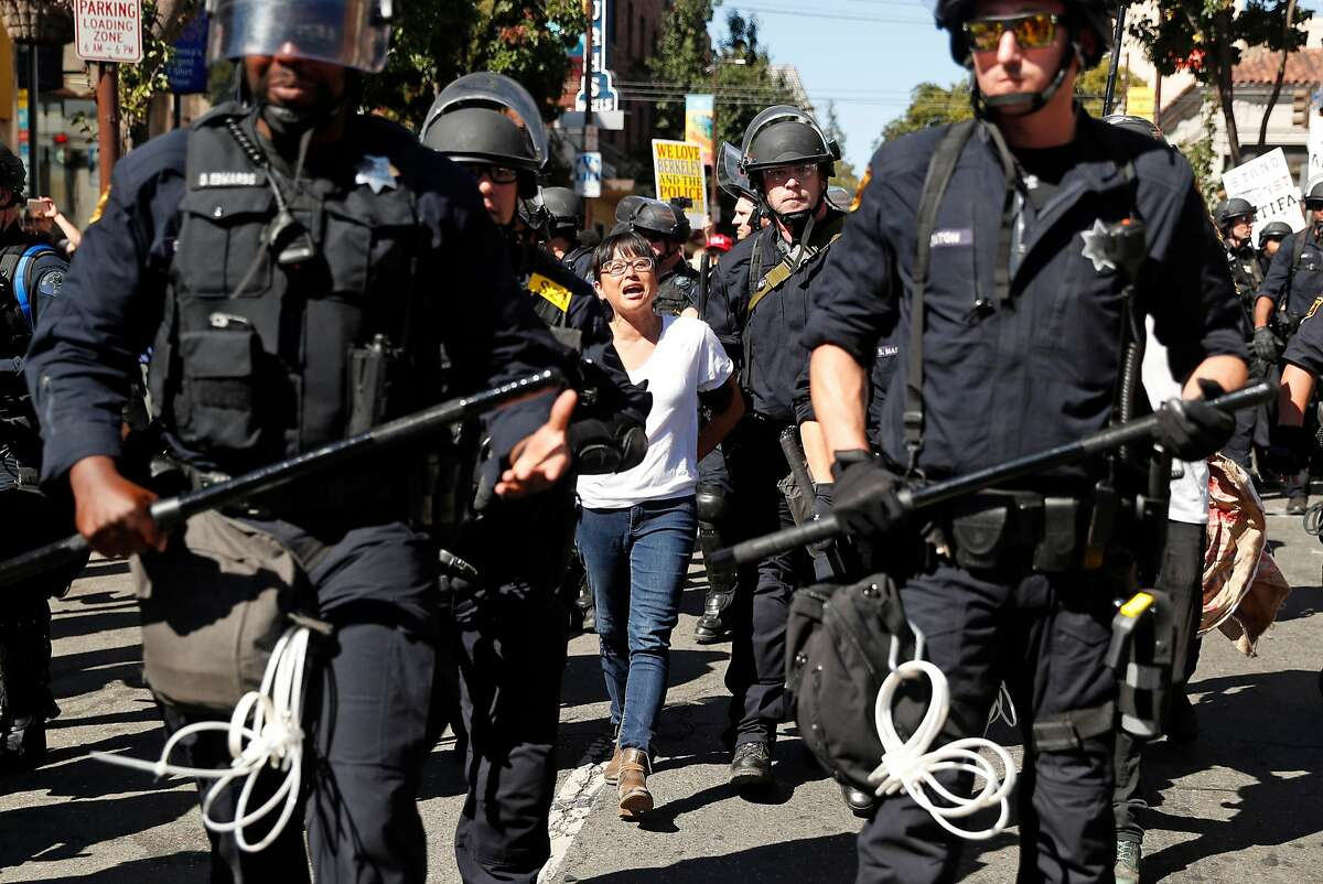 By Any Means Necessary's Yvette Felarca is led down Telegraph Avenue after being arrested in Berkeley, Calif., on Tuesday, September 26, 2017.