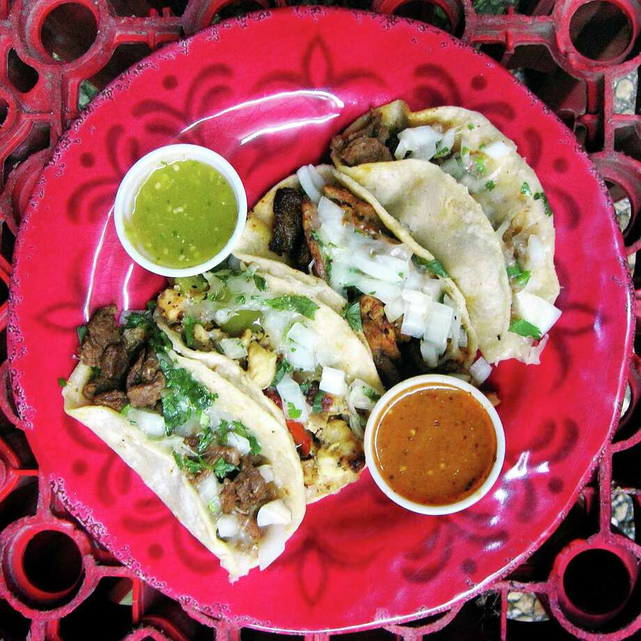 Four mini-tacos with chicken, carne asada, al pastor, cilantro, onions and cheese from Ricky's Tacos. Photo: Mike Sutter /San Antonio Express-News