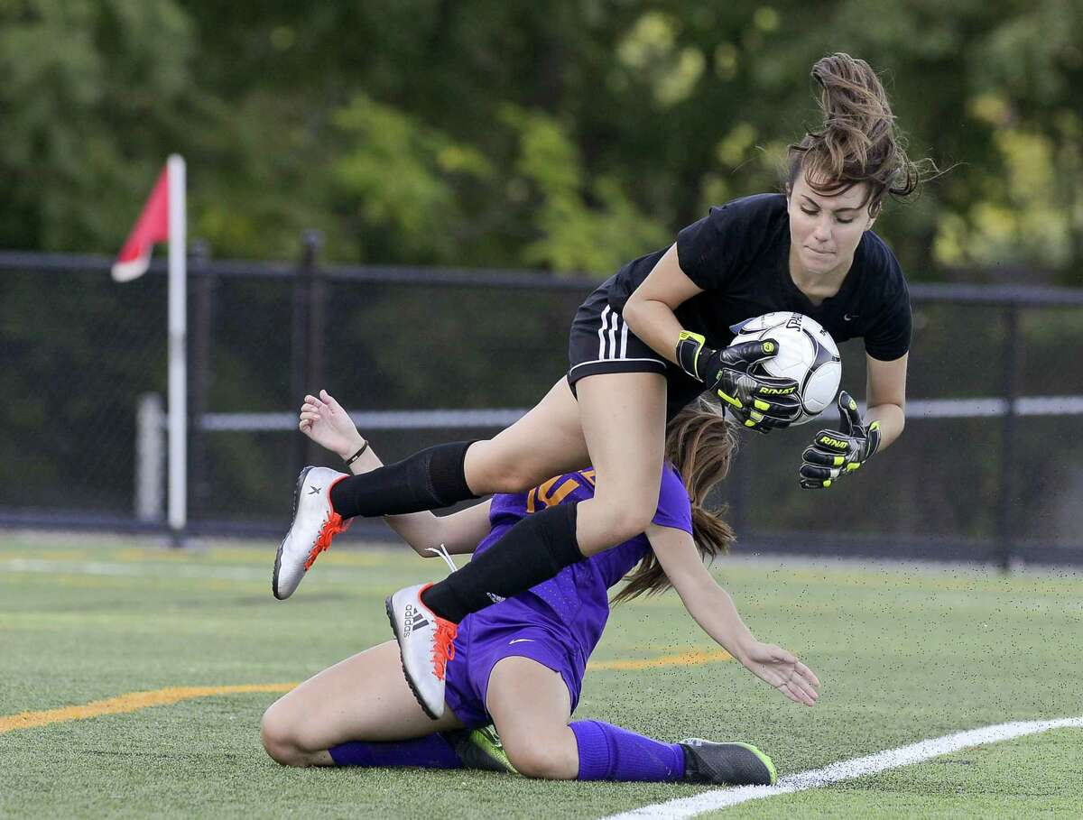 Westhill Amy Orellana Barrientos collides with Trinity goalie Laura Cosentino in a FCIAC girls soccer game at Trinity Catholic High School's Gaglio Field in Stamford, Connecticut on Tuesday, Sept. 27, 2017. Westhill defeated Trinity 4-1.