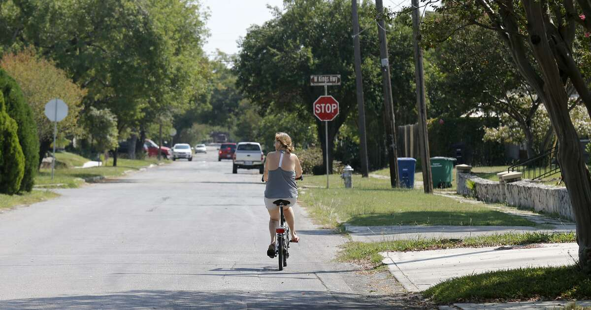 A cyclist rides along Vollum Avenue in the Monticello Park Historic District. Click ahead for the most dangerous intersections for bicyclists in San Antonio.