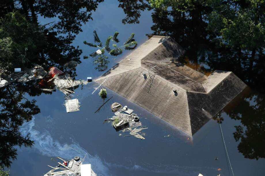 A house in Lumberton is submerged by Harvey floodwaters Sept. 1. Some towns say they are struggling to get help for storm-recovery efforts. Photo: Brett Coomer / Houston Chronicle / © 2017 Houston Chronicle