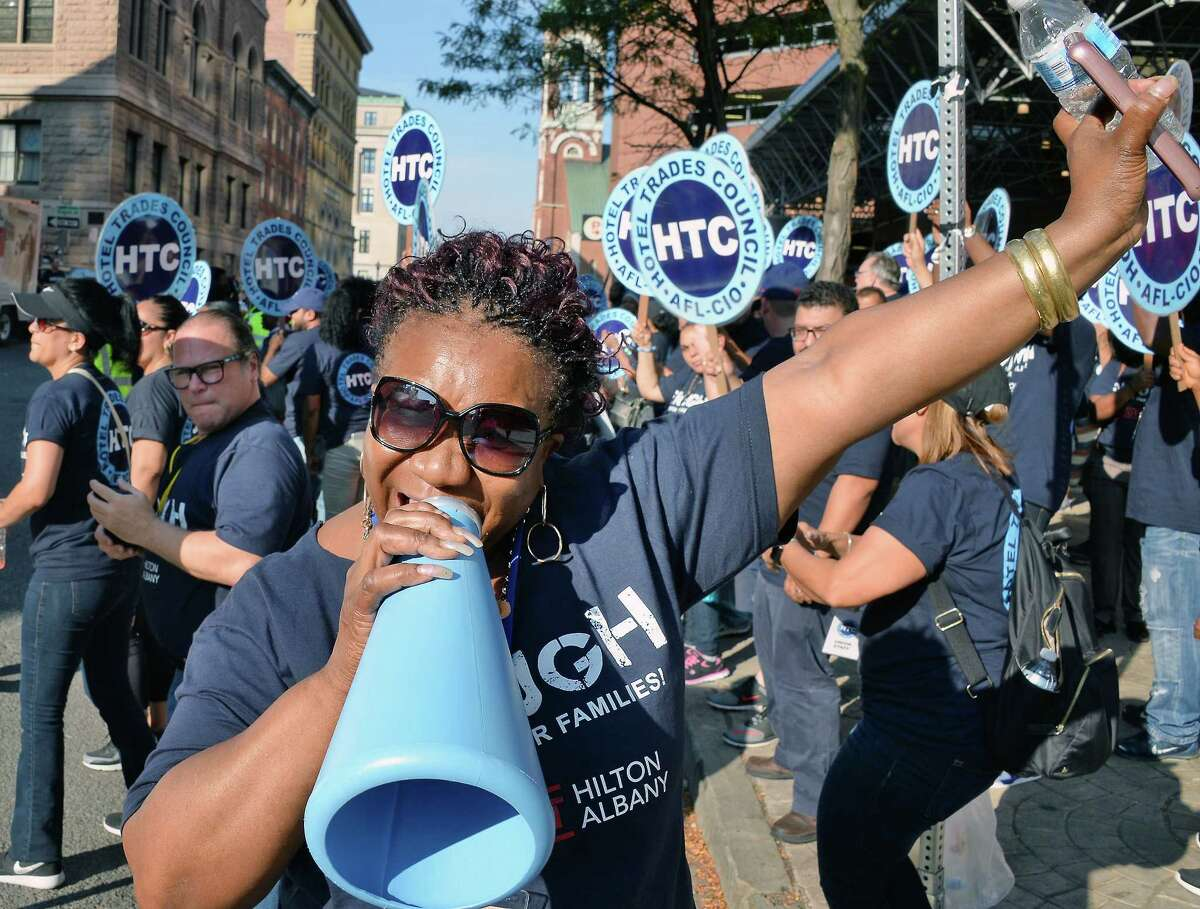 Martha Nunez of NYC joins unionized hotel workers picketing at the Albany Hilton Hotel to protest the lack of a new contract with the hotel owner Tuesday Sept. 26, 2017 in Albany, NY. (John Carl D'Annibale / Times Union)