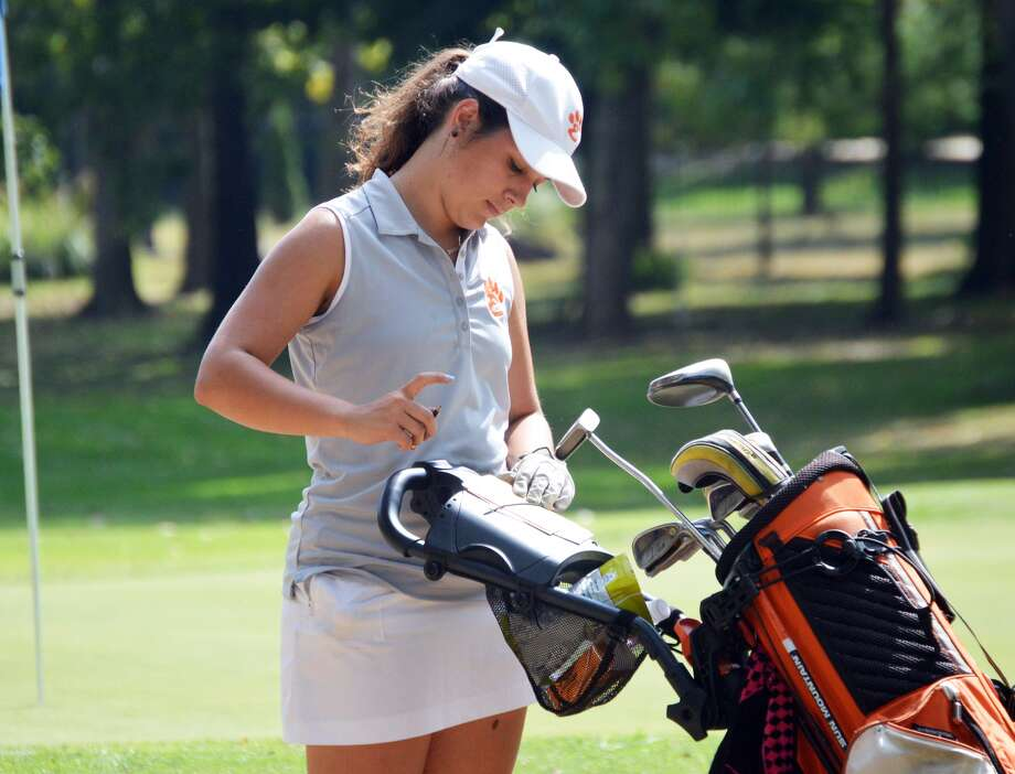 Edwardsville senior Mary Arth looks at her scorecard after completing the ninth hole at The Orchards Golf Course in Belleville during the Southwestern Conference Tournament.