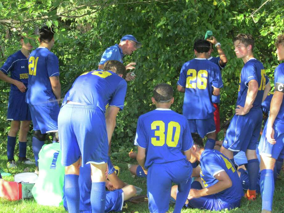 Both teams sought half-time shade after Gilbert withstood a 13-5 Housatonic first-half shot advantage heading toward a good tie for the Yellowjackets. Photo: Peter Wallace / For Hearst Connecticut Media