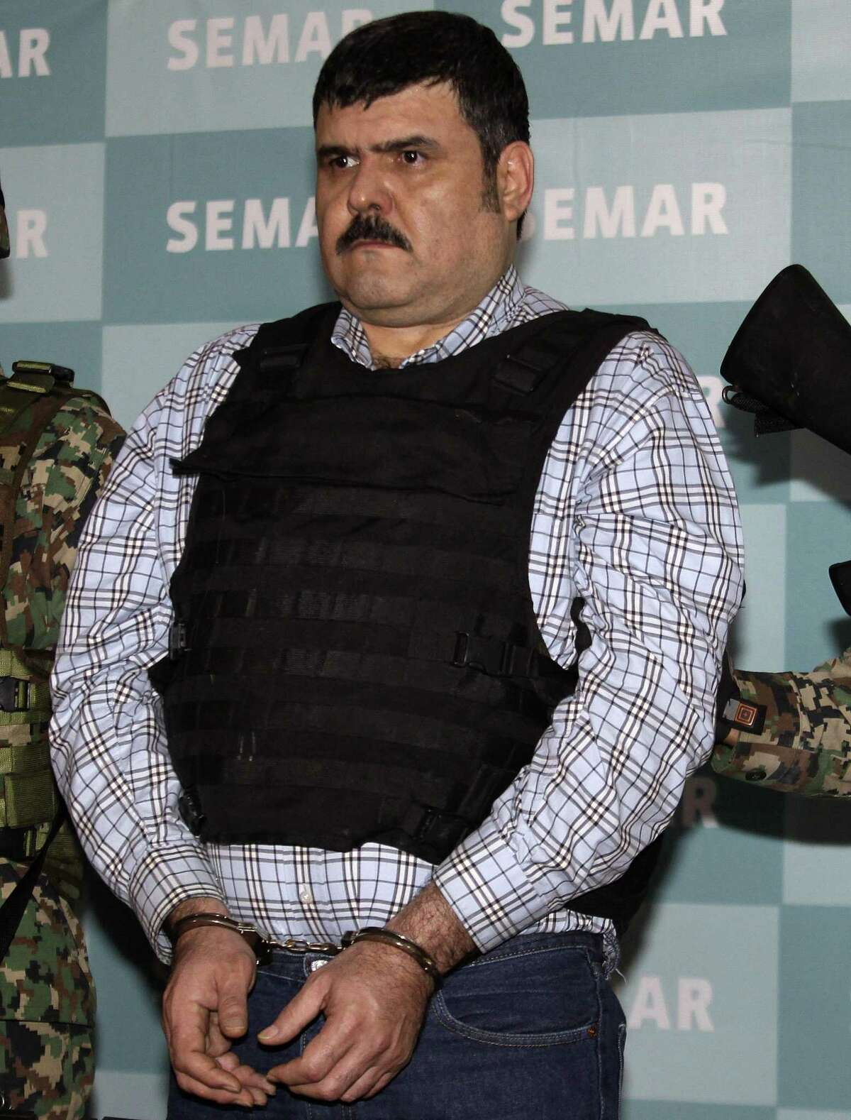 """Jorge Eduardo Costilla Sanchez, aka """"El Coss,"""" is presented to the media in Mexico City in September 2012 after his capture. Costilla has pleaded guilty to conspiracy drug charges and assault, federal authorities said Tuesday."""