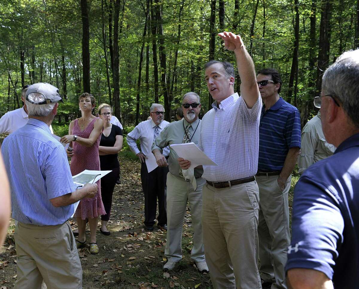 Joel Lindsay, with Ameresco Candlewood Solar LLC, leads a walking tour for the state Siting Council of the area where there is a proposal to build solar panels on Candlewood Mountain in New Milford, Tuesday, Sept. 26, 2017.