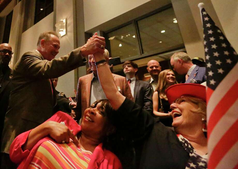 Former Alabama Chief Justice and U.S. Senate candidate Roy Moore, greets supporter Patricia Jones, right, before his election party, Tuesday, Sept. 26, 2017, in Montgomery, Ala.(AP Photo/Brynn Anderson) Photo: Brynn Anderson, STF / Copyright 2017 The Associated Press. All rights reserved.