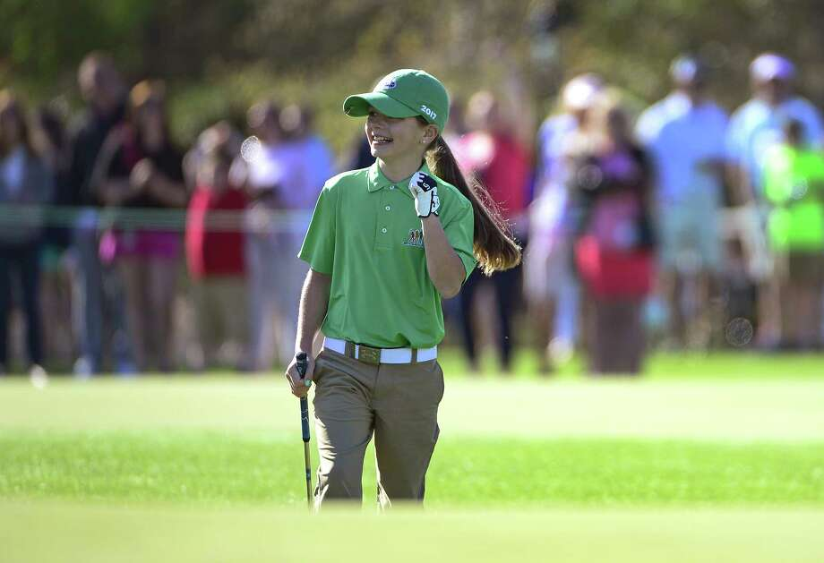 Kennedy Swedick of Voorheesville reacts after sinking her chip during the Girls 10-11 Drive, Chip and Putt National Finals at Augusta National Golf Club, Sunday, April 2, 2017. Photo: Charles Laberge / ©Augusta National 2017
