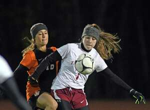Scotia's Taya Leggiero, right, and Mohonasen's Lexi Coelho battle for the ball during their Class A girls' soccer semifinals on Tuesday Oct. 25, 2016 in Stllwater, N.Y.  (Michael P. Farrell/Times Union)