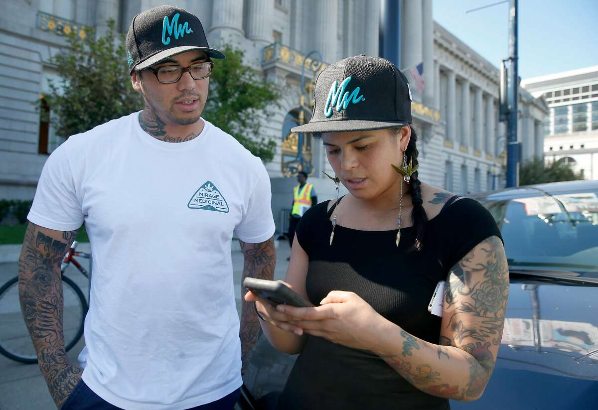 Malcolm Mirage and his sister Nina Parks receive an order for medical cannabis requested by a client on a mobile app before driving it to the patient within 30 minutes in San Francisco, Calif. on Tuesday, Sept. 26, 2017. The brother and sister co-founded Mirage Medicinal three years ago.