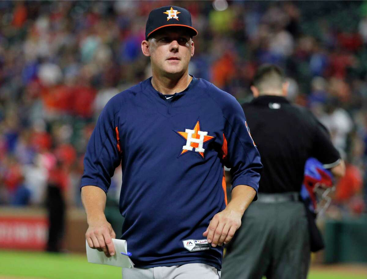 Houston Astros manager A.J. Hinch walks back to the dugout after talking with home plate umpire Carlos Torres in the seventh inning of a baseball game against the Texas Rangers on Tuesday, Sept. 26, 2017, in Arlington, Texas. (AP Photo/Tony Gutierrez)