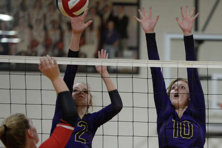 Midland High's Macy Kidwell (2) and Merrick Beach (10) block against Amarillo Tascosa on Sept. 26, 2017, at MHS. James Durbin/Reporter-Telegram Photo: James Durbin