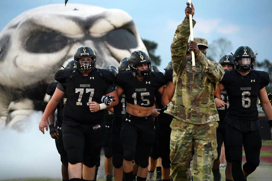 Vidor players are led onto the field by Army Sgt. 1st Class Jonathan Woodard before they take on Central at Pirate Field on Tuesday evening.  Photo taken Tuesday 9/26/17 Ryan Pelham/Enterprise Photo: Ryan Pelham / ©2017 The Beaumont Enterprise/Ryan Pelham