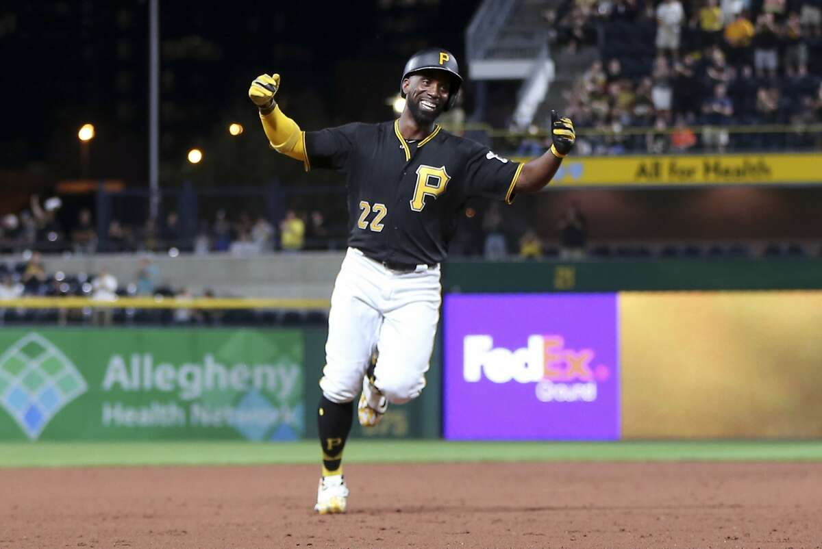 Pittsburgh Pirates' Andrew McCutchen celebrates as he heads to third base after hitting his first career grand-slam home run in the second inning of the baseball game against the Baltimore Orioles on Tuesday, Sept. 26, 2017, in Pittsburgh. (AP Photo/Keith Srakocic)