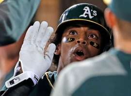 Oakland Athletics' Khris Davis celebrates his 2-run home run in 6th inning against Seattle Mariners during MLB game at Oakland Coliseum in Oakland, Calif., on Tuesday, September 26, 2017.