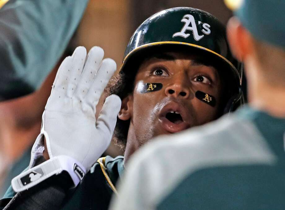 Oakland Athletics' Khris Davis celebrates his 2-run home run in 6th inning against Seattle Mariners during MLB game at Oakland Coliseum in Oakland, Calif., on Tuesday, September 26, 2017. Photo: Scott Strazzante, The Chronicle