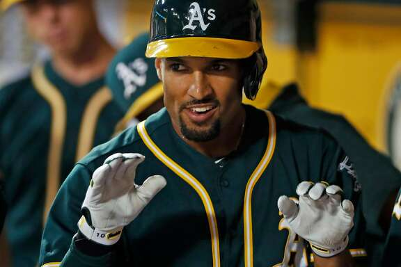Oakland Athletics' Marcus Semien celebrates his solo home run in 1st inning against Seattle Mariners during MLB game at Oakland Coliseum in Oakland, Calif., on Tuesday, September 26, 2017.