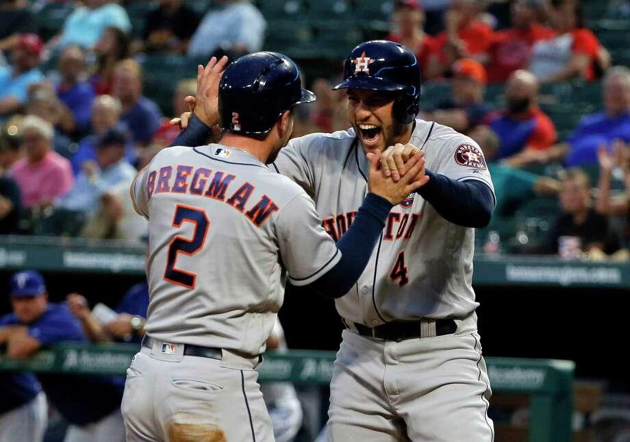 Alex Bregman, left, and George Springer get the Astros started Tuesday night by scoring on a Carlos Correa double in the four-run first inning. Photo: Tony Gutierrez, STF / Copyright 2017 The Associated Press. All rights reserved.