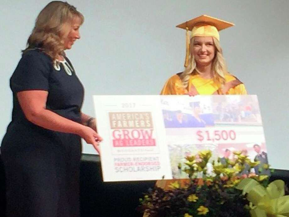 Skyler Kruger, right, of Bay City Western High School, recently received a $1,500 American's Farmers Grow Ag Leaders scholarship through the National FFA Organization.