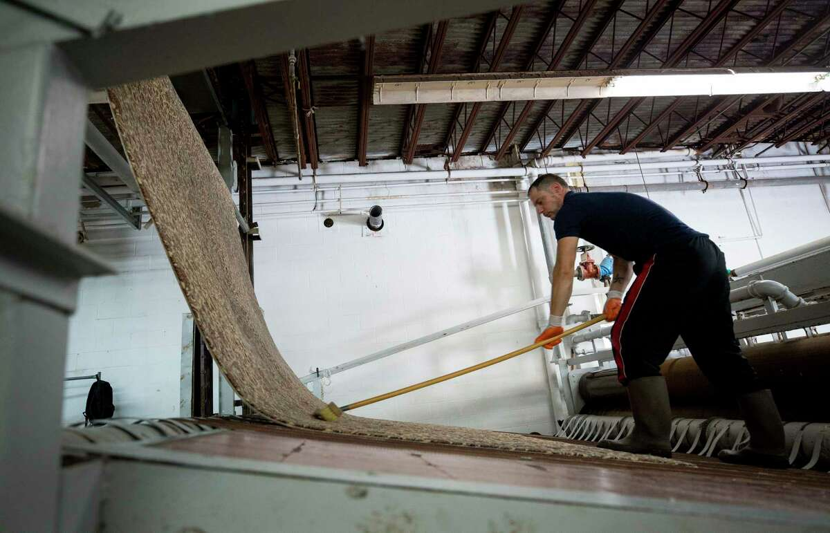 Brandon Chiarello works on cleaning a rug that was damaged during Hurricane Harvey inside Bagdad Oriental Rugs Tuesday, Sept. 26, 2017, in Houston. ( Godofredo A. Vasquez / Houston Chronicle )