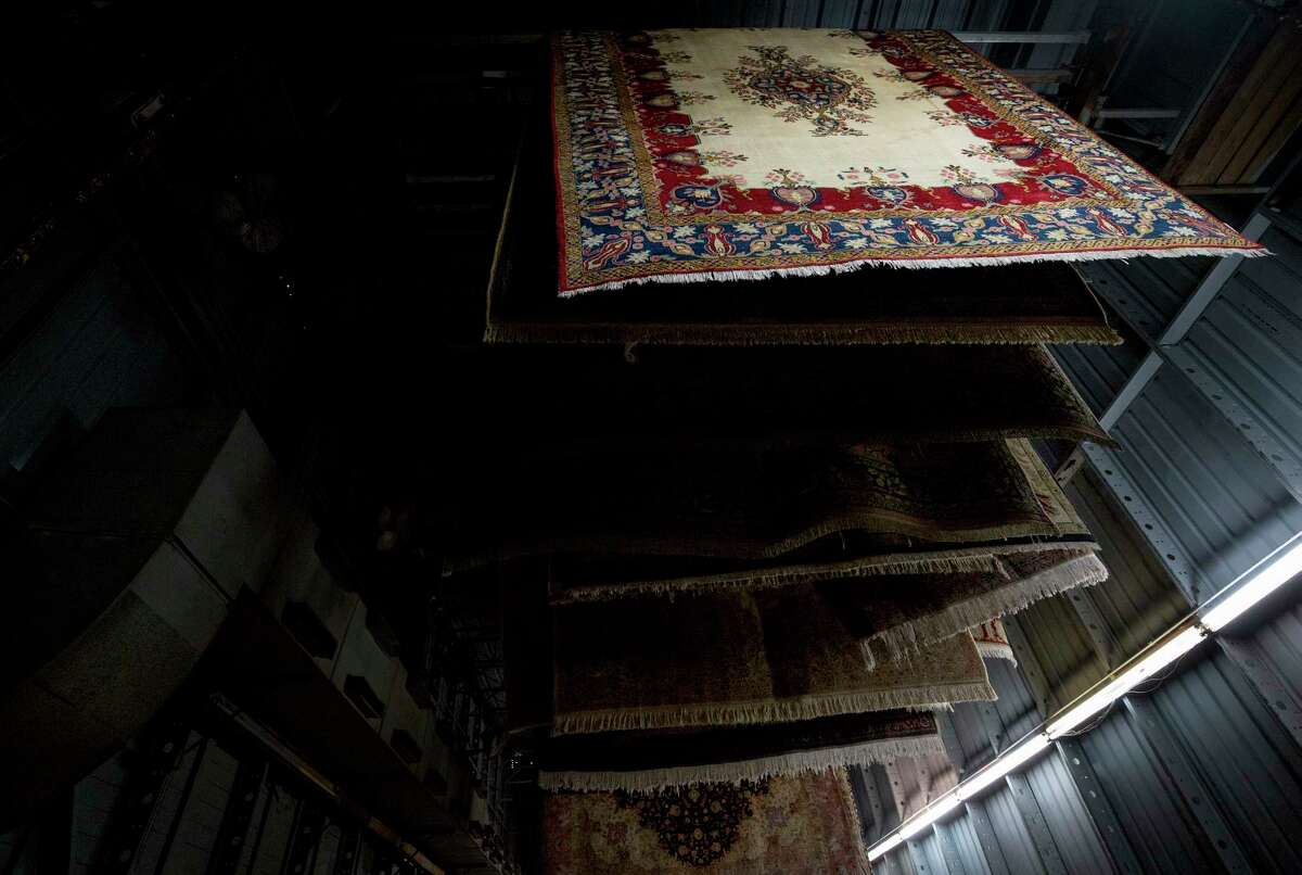 Rugs that have been washed and rinsed are hung to dry inside Bagdad Oriental Rugs Tuesday, Sept. 26, 2017, in Houston. ( Godofredo A. Vasquez / Houston Chronicle )