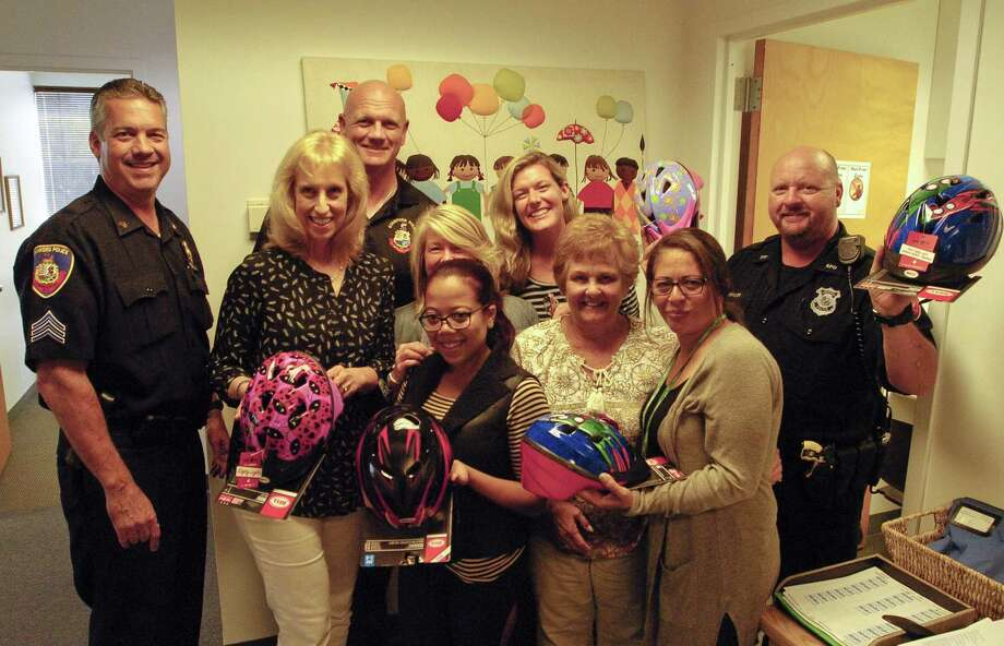 Sgt. Chris Gioielli, Sgt Kris Engstrand and Police Officer John Buehler, all of the Stamford Police Association drop off child bike helmets with representatives of Abilis Therapeutic Services in Stamford, Connecticut on Tuesday, Sept. 27, 2017. The Officers visited several non-profits and day care organizations through out the city, distributing 70 bike helmets that will go to needy families. Photo: Matthew Brown / Hearst Connecticut Media / Stamford Advocate