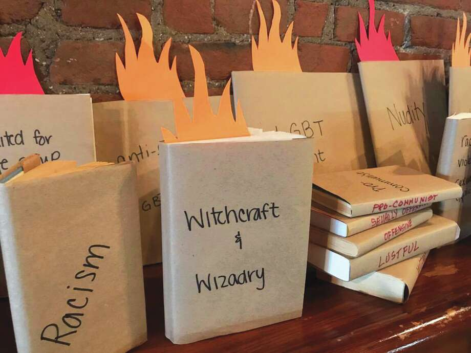 Pictured are some of the Edwardsville Public Library's banned books, on display at Sacred Grounds all week long. These books are part of the library's Banned Book Week and will be on-site until Saturday, Sept. 30. Photo: Susan Carr • For The Intelligencer