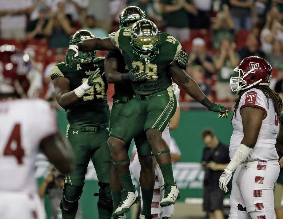 AAC POWER RANKINGS1. USF (4-0, 1-0 AAC)Exactly 11 months after being gashed by Temple's power-run attack, the Bulls allowed only 85 total yards (fewest ever surrendered to a Division I foe in program history) in Thursday's 43-7 romp of the Owls. The 18th-ranked Bulls now rank third nationally in run defense (66.0 ypg) after finishing118th in that category (240.3 ypg) this time last season. On Saturday, they visit East Carolina hoping to extend their program-record win streak to 10 games. - Joey Knight, Tampa Bay Times Photo: Chris O'Meara, Associated Press / Copyright 2017 The Associated Press. All rights reserved.