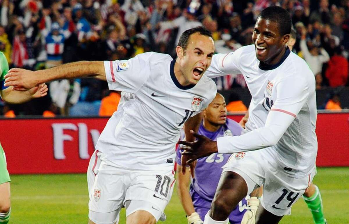 PRETORIA, SOUTH AFRICA - JUNE 23: Landon Donovan of the United States celebrates with teammate Edson Buddle after scoring the winning goal that sends the USA through to the second round during the 2010 FIFA World Cup South Africa Group C match between USA and Algeria at the Loftus Versfeld Stadium on June 23, 2010 in Tshwane/Pretoria, South Africa. (Photo by Kevork Djansezian/Getty Images) *** Local Caption *** Landon Donovan;Edson Buddle