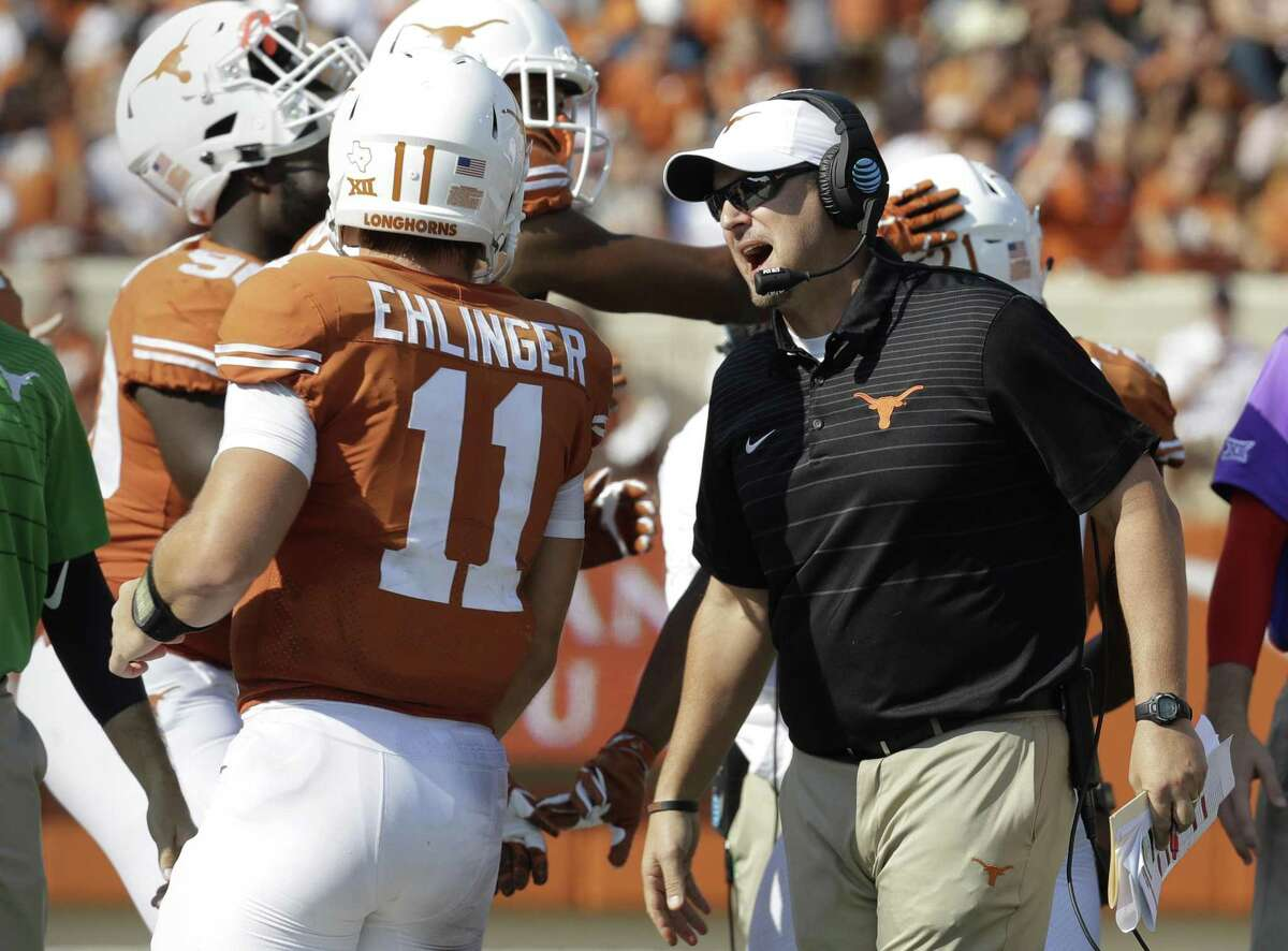 In this Saturday, Sept. 9, 2017, file photo, Texas head coach Tom Herman, right, talks to quarterback Sam Ehlinger (11) during the second half of an NCAA college football game against San Jose State in Austin.