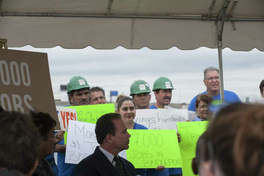 Union workers hold signs in mid-September 2017 in back of Bridgeport, Conn. Mayor Joseph Ganim, in support of MGM's proposal to build a casino in the city that would add thousands of jobs. On Sept. 27, 2017, the U.S. Bureau of Labor Statistics released a report estimating the Bridgeport region was in the bottom 30 percent of metropolitan areas nationally for job creation in August. Photographer: Douglas Healey/Bloomberg Photo: Douglas Healey / Bloomberg / © 2017 Bloomberg Finance LP