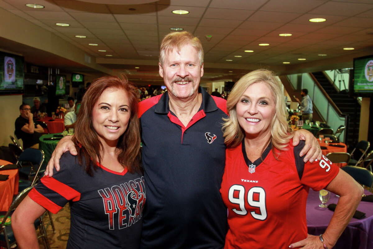 Auction chairs DeeDee and Clay Rawlings, from left, and Karen De Geurin at the Fantasy Football Draft Night at NRG. (For the Chronicle/Gary Fountain, September 26, 2017)