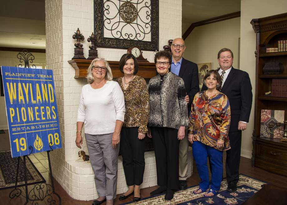 Dr. Glenda Lightfoot Payas and husband Brad Payas (center) celebrate the dedication of two new endowed scholarships they donated to Wayland Baptist University at a luncheon with Dr. and Mrs. Bobby Hall (right), president and first lady of the university. Payas' sister Gayle Lightfoot Blue-Sky (second from left) and Penny Cameron Anderson, their friend and fellow WBU alumnus, joined them. Both Gayle and Glenda earned bachelor's degrees from Wayland.