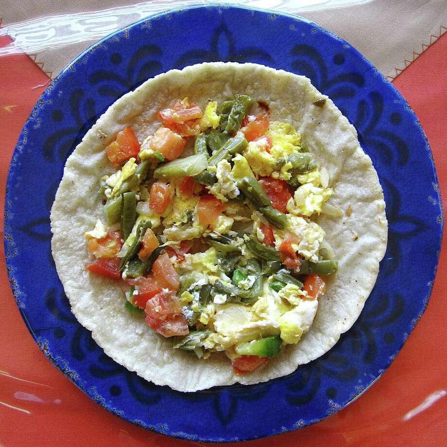 Taco of the Week: Nopales con huevos a la mexicana taco on a handmade corn tortilla from Mama's Kitchen. Photo: Mike Sutter /San Antonio Express-News