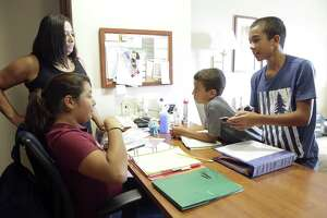 Three sixth graders get together to do homework with Marta Moody as Lori Bailey (Marts's daughter) manages her children, just home from school, at an apartment in Northwest in San Antonio on September 19, 2017. Kids are from left, Dakota Rimirez, Adriel Bailey and Gaige Bailey.