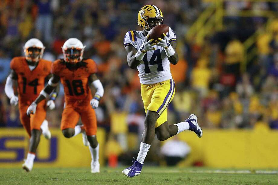 BATON ROUGE, LA - SEPTEMBER 23: Drake Davis #14 of the LSU Tigers catches the ball for a touchdown during the second half of a game against the Syracuse Orange at Tiger Stadium on September 23, 2017 in Baton Rouge, Louisiana. (Photo by Jonathan Bachman/Getty Images) Photo: Jonathan Bachman, Stringer / 2017 Getty Images