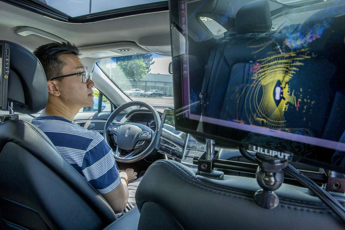 Robin Cha tests the self driving car by Drive.ai on Wednesday, Aug. 9, 2017, in Mountain View, Calif. Drive.ai is a Silicon Valley startup that's creating artificial intelligence software for autonomous vehicles.