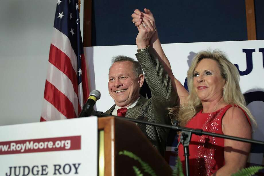 Republican U.S. Senate candidate Roy Moore and his wife, Kayla, greet supporters in Montgomery, Ala., after winning a primary election runoff vote on Tuesday. Photo: Scott Olson