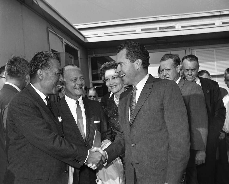 Original caption: Vice President Richard M. Nixon is greeted by Senator Hiram Fong (R-Hawaii) as he arrived at Washington National Airport on August 2, 1960 to take off on his first presidential campaign swing.  In center are Secretary of Interior Fred Seaton and Mrs. Nixon. The Senator and the Secretary are accompanying the Nixons on the five day trip which will include stops in Reno, Nev., Los Angeles and Whittier, Calif. Hawaii and Seattle. (AP Photo) Photo: BYRON ROLLINS/AP