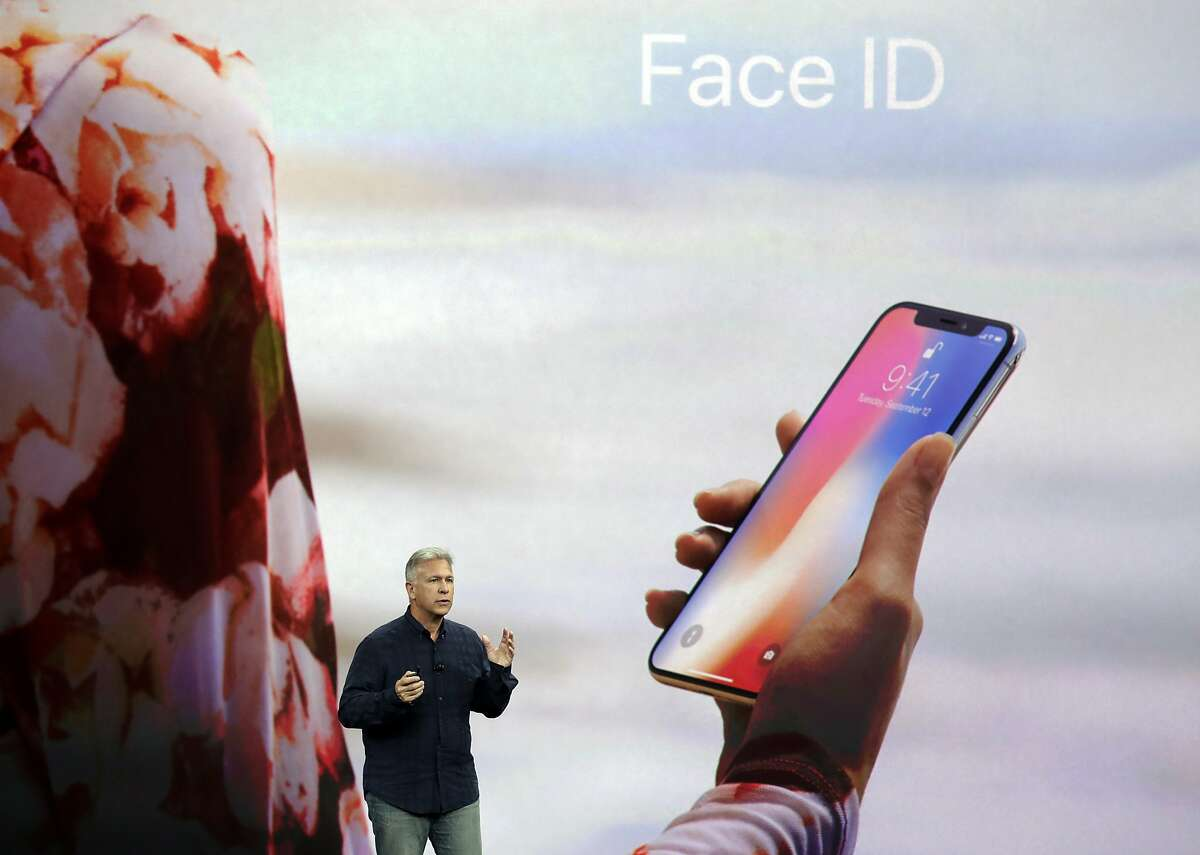 FILE - In this Tuesday, Sept. 12, 2017, file photo, Phil Schiller, Apple's senior vice president of worldwide marketing, announces features of the new iPhone X, including Face ID, at the Steve Jobs Theater on the new Apple campus, in Cupertino, Calif. Apple's new Face ID facial recognition system is due to debut with the iPhone X on Nov. 3. The system lets users unlock their phones just by glancing at them, but have also raised privacy questions and some anxieties over the ease with which others unlock a user's phone. (AP Photo/Marcio Jose Sanchez, File)