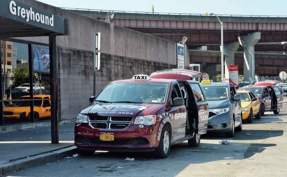 A line of taxis wait for fares at the bus station on Wednesday, Sept. 27, 2017, in Albany, N.Y.  (John Carl D'Annibale / Times Union) Photo: John Carl D'Annibale, Albany Times Union / 40041700A