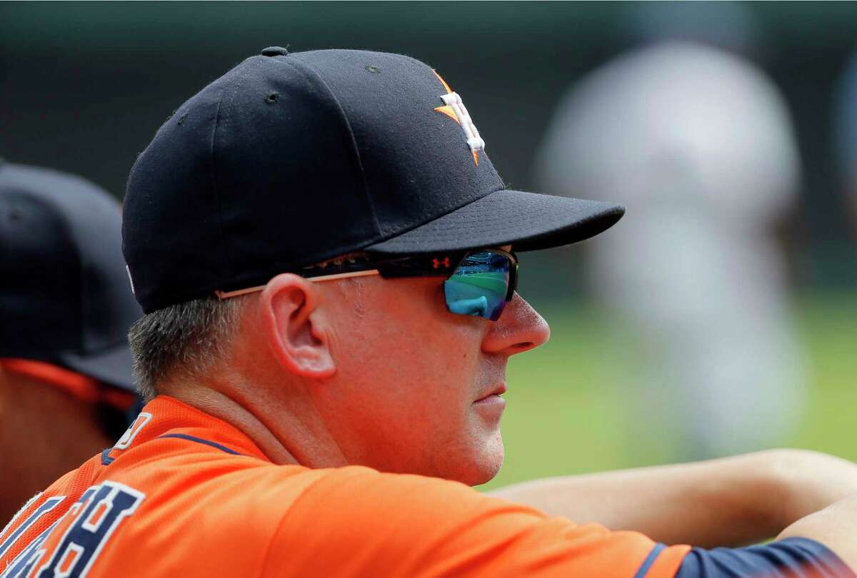 Houston Astros manager A.J. Hinch watches play in the first inning of a baseball game against the Texas Rangers on Wednesday, Sept. 27, 2017, in Arlington, Texas. (AP Photo/Tony Gutierrez)